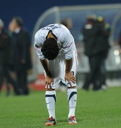 Team USA defender Jonathan Bornstein hangs his head in disappointment after Ghana defeated the Americans in the round of 16.