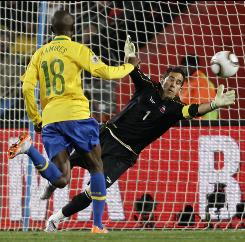 Chile goalkeeper Claudio Bravo, right, fails to stop a goal by Brazil's Robinho, not pictured, during the World Cup round of 16 match between Brazil and Chile in Johannesburg.
