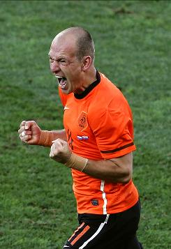 Netherlands forward Arjen Robben celebrates after scoring the opening goal during the World Cup Round of 16 match between the Netherlands and Slovakia in Durban, South Africa.