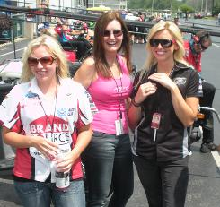 Brittany Force, left, Laurie Force, center, and Courtney Force stand in the staging lanes getting to watch the semifinal round of eliminations in Norwalk, Ohio.
