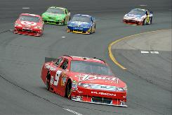 Kasey Kahne (9) started second and led 110 laps at New Hampshire, but he finished a disappointing 36th, a result that highlighted Ford drivers' recent Sprint Cup struggles.