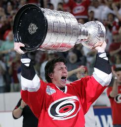 Carolina Hurricanes center Rod Brind'Amour raises the Stanley Cup after a Game 7 victory against the Edmonton Oilers in 2006.