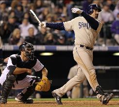 Adrian Gonzalez, who many thought would be on the way out by now, has been the Padres' offensive catalyst with 16 homers and 50 RBI entering Tuesday.