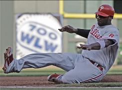 The Phillies' Ryan Howard, sliding into third on a sacrifice fly by Raul Ibanez in the second inning, scored the game-winning run in the 10th inning.