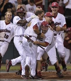 South Carolina's baseball team celebrates after the Gamecocks defeated UCLA in 11 innings to win its first NCAA baseball championship.