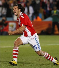 Paraguay's Nelson Haedo Valdez celebrates after scoring during penalty shootouts at the World Cup Round of 16 match between Paraguay and Japan in Pretoria, South Africa.