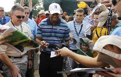 Tiger Woods signs autographs for fans after a practice round Tuesday in advance of the AT&T National at Aronimink Golf Club in Newtown Square, Pa.