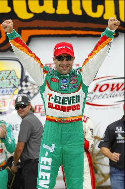 Andretti Autosport driver Tony Kanaan celebrates his win in the Iowa Corn Indy 250 June 20 at Iowa Speedway.