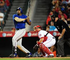 The Rangers' Vladimir Guerrero punished his former team, going 4-for-4 with two home runs and five RBI.