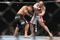 Shane Carwin, right, taking a swing at Frank Mir during their UFC 111 heavyweight match on March 27, is speaking his mind via tweets.