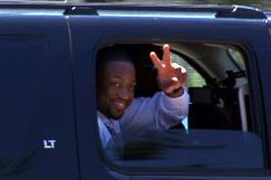 Free agent Dwyane Wade leaves the United Center after a meeting with the Chicago Bulls.