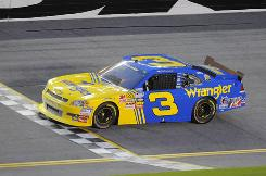 Dale Earnhardt Jr., driving a No. 3 car in honor of his late father, won his first Nationwide race since 2006 in Michigan.