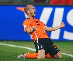 Wesley Sneijder of the Netherlands celebrates scoring his team's second goal against Brazil.