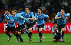 The Uruguay team celebrate as Sebastian Abreu scores the winning kick in a penalty shootout during the match between Uruguay and Ghana on Friday in Johannesburg.
