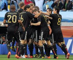 Germany's Thomas Mueller (13) is congratulated by teammates after scoring the opening goal during their 4-0 rout of Argentina in the World Cup quarterfinals.
