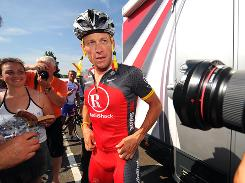 Lance Armstrong speaks to reporters during a training session before the 2010 Tour de France. On Saturday, Armstrong again dismissed claims of doping by former teammate Floyd Landis.