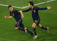 Spain's David Villa celebrates after he scores his side's first goal with teammate Francesc Fabregas during their 1-0 victory over Paraguay in the World Cup quarterfinals.