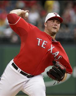 Texas Rangers starting pitcher Tommy Hunter stayed unbeaten at 5-0 win a win over the Chicago White Sox.