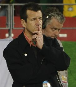 Dunga watches his Brazilian side lose to the Netherlands during their quarterfinal on Friday.