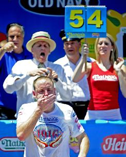 American Joey Chestnut won the annual hot dog eating contest on Sunday.