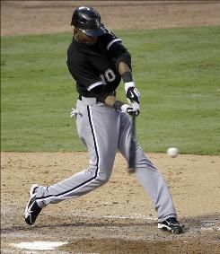 Chicago's Alexei Ramirez lines a go-ahead, two-run homer off Texas starter Scott Feldman in the sixth inning to propel the White Sox to a 5-3 win.