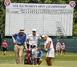 Suzann Pettersen of Norway, right, practice chipping onto the 18th green under the watchful eye of her coach David Leadbetter, left, during a practice round for the U.S. Women's Open at Oakmont Country Club in Oakmont, Pa.