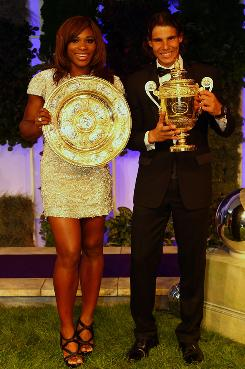 Serena Williams of the USA and Rafael Nadal of Spain show off the spoils of their victories at Wimbledon. The two solidified their places at the top of tennis and now are looking ahead to the U.S. Open.