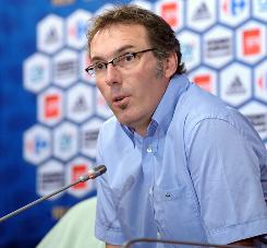Former France national team defender Laurent Blanc talks to the media during a news conference discussing his plans for the national team in Paris on Tuesday.