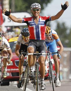 Norway's Thor Hushovd raises his arms in triumph after crossing the finish line to win the third stage of the Tour de France.