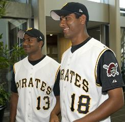 Pirates pitching prospects Dinesh Patel, left, and Rinku Singh have assimilated well into U.S. culture.