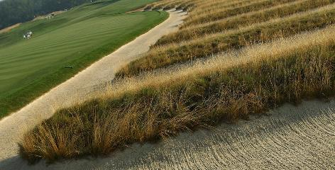 The Church Pew bunkers, which have 12 slivers of grass in the middle, are more than 100 yards of trouble. If a player hits in the bunker, it can be hard to get out.