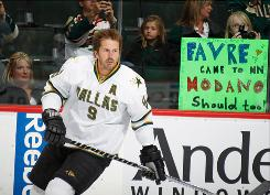 Mike Modano, skating by a sign April 10 before a game vs. the Wild, is being pursued by the Red Wings, who have a history of adding veteran players.
