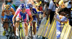 Italy's Alessandro Petacchi sprints to the finish line to win the fourth stage of the Tour de France in Reims.
