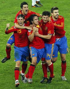 Spain teammates mob Carles Puyol, third from left, after his 73rd-minute goal against Germany in their World Cup semifinal. Puyol's goal was enough to put Spain into its first World Cup final, which will be on Sunday against the Netherlands.