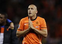 Netherlands' John Heitinga puts his hands together during the Dutch's World Cup semifinal win against Uruguay in Cape Town, South Africa on Tuesday. Heitinga and the Netherlands will have a Dutch priest praying for them during Sunday's World Cup Final against Spain.