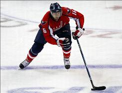 Washington Capitals right wing Eric Fehr skates in on a breakaway against the Montreal Canadiens during the 2010 Stanley Cup Playoffs. Fehr agreed to re-sign with the Capitals for $4.4 million over the next two years.