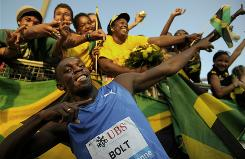 Jamaican sprinter Usain Bolt celebrates with fans after winning the 100 meters at the Athletissima meet.