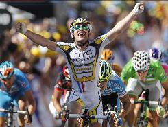 Mark Cavendish crosses the finish line to win the fifth stage of the Tour de France.