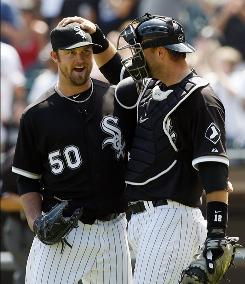 White Sox starter John Danks, left, celebrates with catcher A.J. Pierzynski after recording the final out of his two-hitter and first career shutout.