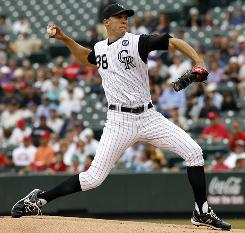Rockies starter Ubaldo Jimenez delivers to the plate in the first inning against the Cardinals.