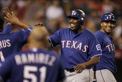 The Rangers' Vladimir Guerrero, center, was cheered by Angels fans despite hitting three homers against his former team.