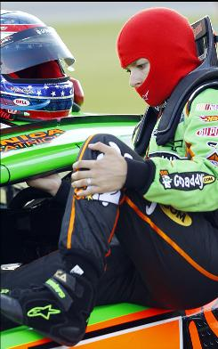 Nationwide Series driver Danica Patrick climbs into her car during the Dollar General 300 at Chicagoland Speedway in Joliet, Ill.