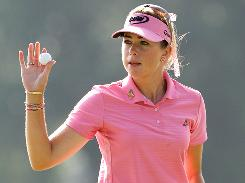 Paula Creamer waves after making a birdie on the ninth hole during the continuation of round two of the U.S. Women's Open at Oakmont.