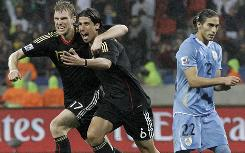 Germany's Sami Khedira, center, celebrates with teammate Per Mertesacker after scoring the winning goal as Uruguay's Martin Caceres looks on during the World Cup's third-place match.