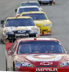 Juan Pablo Montoya leads a pack of drivers through a turn during the Lifelock.com 400 in Chicago.