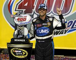 David Reutimann celebrates in victory lane after winning the Lifelock.com 400 at Chicagoland Speedway.