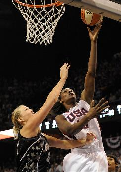 Team USA's Sylvia Fowles scores two of her game-high 23 points while being guarded by WNBA All-Star Jayne Appel.