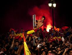 Spanish fans celebrate Andres Iniesta's goal against the Netherlands as they watch the World Cup final in Barcelona's Plaza Espana.