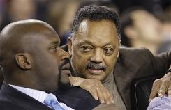 Jesse Jackson, right, is seen with LeBron James' former teammate Shaquille O'Neal during the 2010 NBA All-Star game. Jackson criticized Cleveland owner Dan Gilbert for his comments after James announced he would sign with Miami on Thursday.