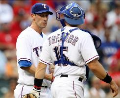 The Rangers' Cliff Lee, left, lost his first decision with his new team, but he is being counted on to help win the Americal League West.
